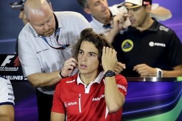 TV crew prepare Manor Marussia Formula One driver Merhi and Lotus driver Maldonado for the drivers news conference ahead of the Singapore F1 Grand Prix