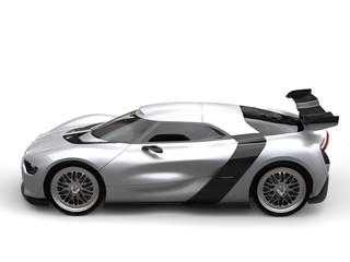 Bright metallic silver super car - side angle