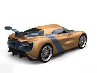 Gold leaf painted modern super sports car - back view