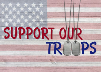 inspirational support our troops phrase with military dog tags on rustic American flag background