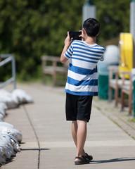 Young asian tourist taking photos