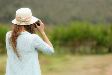 Woman taking photo of nature scene