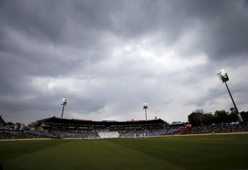 Clouds gather around the stadium during the fourth cricket test match between South Africa and England in Centurion