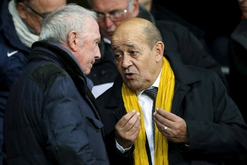 French Defence Minister Le Drian talks with French businessman Pinault before the French Ligue 1 soccer match between Stade Rennes and Paris St Germain at the Roazhon Park stadium in Rennes
