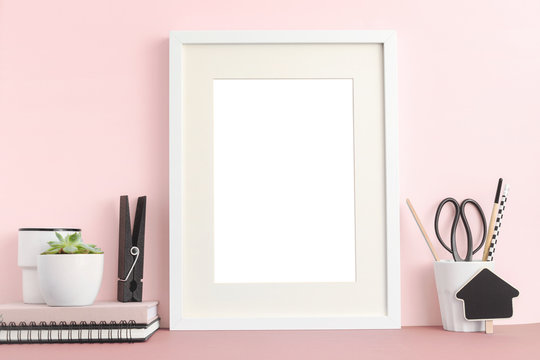 Frame on pink desk. mock up.