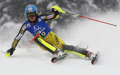 Mielzynski of Canada clears a pole in the first run of the women's Alpine Skiing World Cup slalom race in Flachau