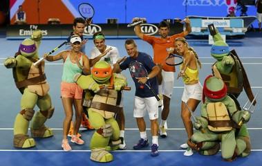 Denmark's Wozniacki, Canada's Raonic, Switzerland's Federer, Australia's Hewitt, Serbia's Djokovic and Belarus' Azarenka pose during Kids Tennis Day at Melbourne Park, Australia