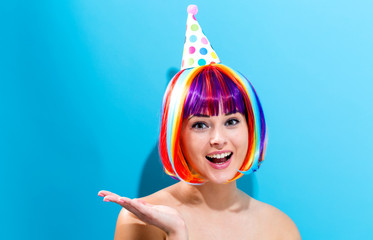 Wall Mural - Party theme with a woman in a colorful wig
