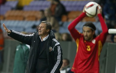 Belarus' coach Khatskevich gestures as Macedonia's Zhuta prepares before throwing a ball during their Euro 2016 group C qualifying soccer match at the Borisov Arena outside Minsk
