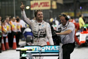 Mercedes Formula One driver Rosberg of Germany celebrates after winning the Abu Dhabi F1 Grand Prix at the Yas Marina circuit in Abu Dhabi