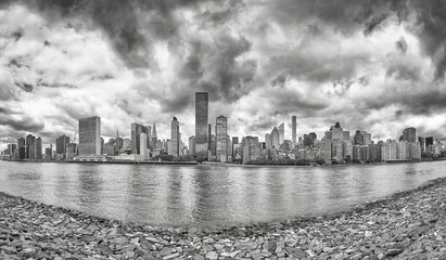Black and white Manhattan panorama seen from Roosevelt Island, New York City, USA.
