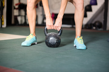 Woman exercise with kettle bells