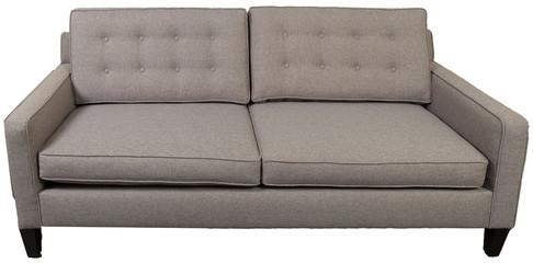 mid-century gray sofa against white background
