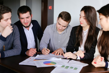 Managers of two men and women are engaged in approving programs