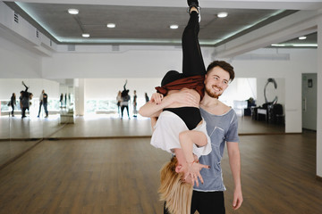 Young modern dancers dancing in the studio. Sport, dancing and urban culture concept
