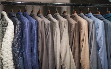Men suits in detail in a store