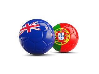 Two footballs with flags of New Zealand and Portugal isolated on white