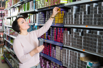 Woman choosing hair dye