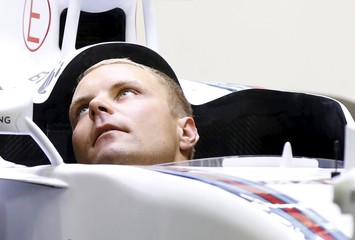 Williams Formula One driver Valtteri Bottas of Finland sits in the cockpit of his car ahead of the Singapore F1 Grand Prix night race in Singapore