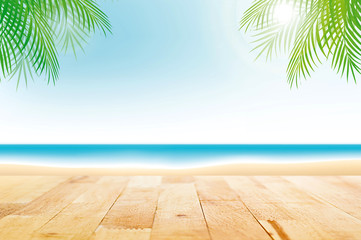 Wood table top on summer beach background