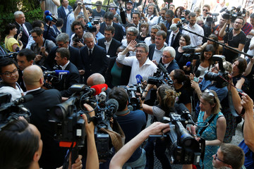 Jean-Luc Melenchon, of La France Insoumise party, arrives with his newly-elected fellow members of parliament at the National Assembly in Paris