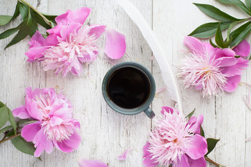 coffe -  flowers, peonies on a wooden table. Woman's desk.