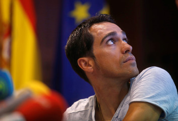 Contador of Spain attends a news conference after a medical examination following his multiple falls in the Tour de France in Madrid