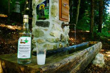 A bottle and a glass of absinthe are pictured in this picture illustration taken at the Fontaine des Fees in Buttes