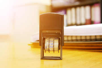 Stamper on office desk with light rays as selective focus