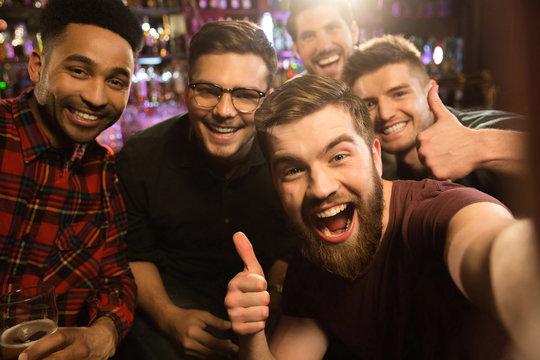 Cheerful old friends having fun by taking selfie