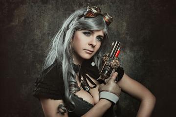 Steampunk woman with mechanical gun
