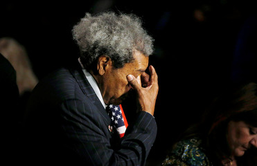 Promoter Don King wipes his eyes as he arrives for the funeral service for the late boxer Muhammad Ali in Louisville