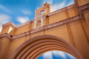 Santa Catalina's Arch against the blue sky with moving clouds in Antigua in Guatemala.