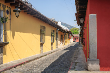 A side street with Colorful Houses on a sunny afternoon in Antigua, Guatemala.