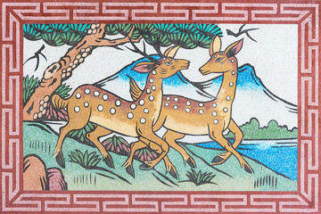 couples deers picture on wall in Chinese temple