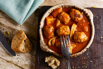 spanish albondigas con sepia, meatballs with cuttlefish