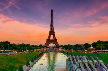 Sunset view of Eiffel Tower from fountain in Jardins du Trocadero in Paris, France. Eiffel Tower is one of the most iconic landmarks of Paris
