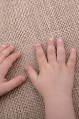 Toddler hand with canvas background