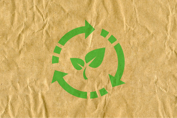 symbol for refuse reuse recycle with cardboard background