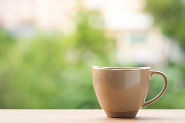 Coffee mug on wooden table.
