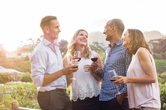 Happy friends drinking wine