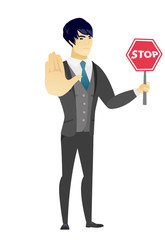 Asian groom holding stop road sign.