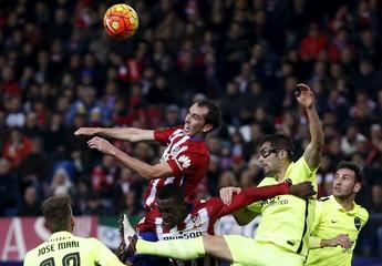 Atletico Madrid's Godin, Martinez and Levante's Jose Mari and Trujillo in action.