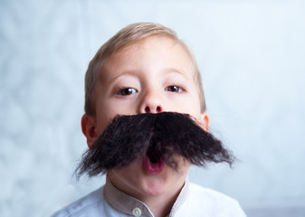 A little boy with a mustache