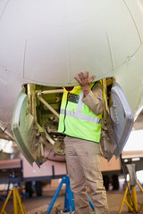 Aircraft worker checking airplane