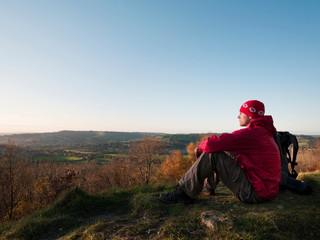 Hiker overlooking rural landscape