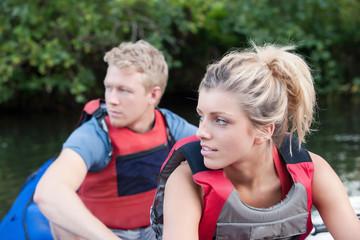 Couple kayaking in creek