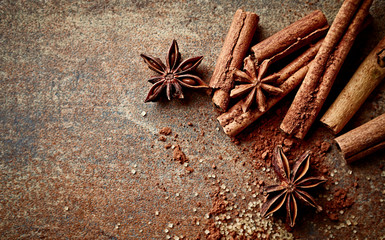 Assorted natural baking ingredients on a rustic background