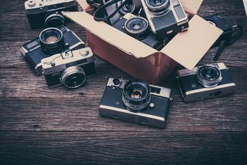 Retro film photo camera on wooden background