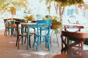 Cafe with different color chairs